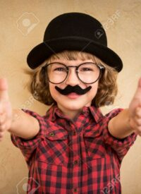 46594531-funny-kid-with-fake-mustache-happy-child-playing-in-home
